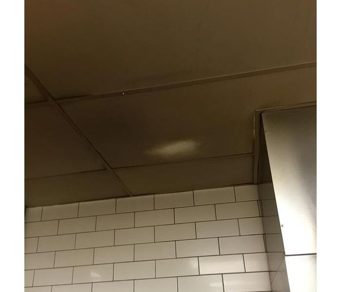Ceiling Tile in a BBQ restaurant before cleaning