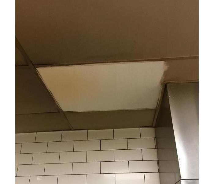 Ceiling Tile in a BBQ restaurant after test cleaning